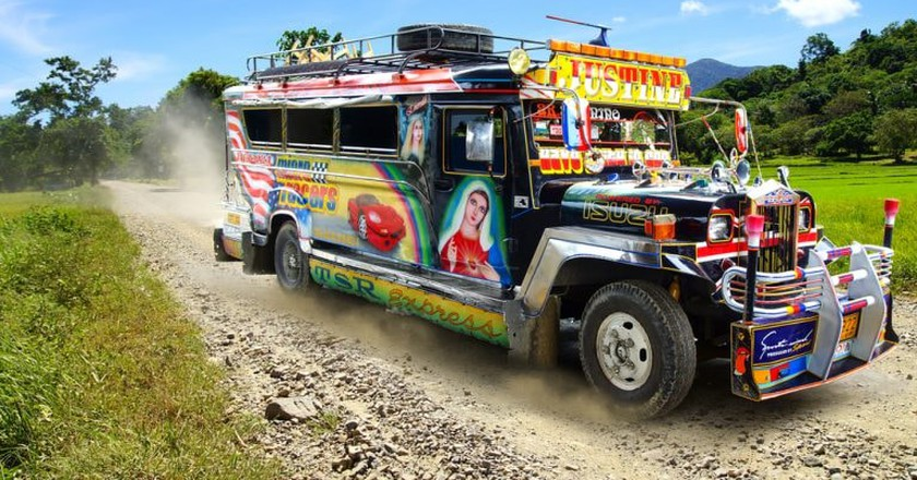 Jeepney with race car and Virgin Mary image