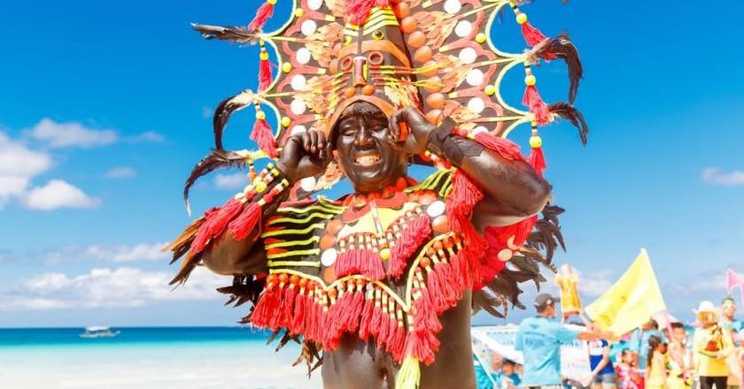 Man in colorful headdress in Ati-Atihan in Boracay    © Frolova_Elena/ Shutterstock
