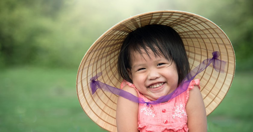 A young Vietnamese girl says hello   © CRStudio / Shutterstock