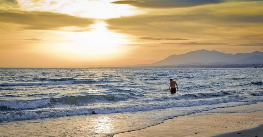 Sunset on a Marbella beach; Hernán Piñera/flickr