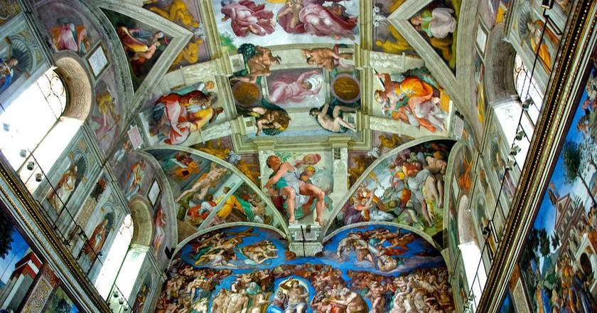 Michelangelo's frescos provide the backdrop for the Sistine Chapel Choir | © BriYYZ/Flickr