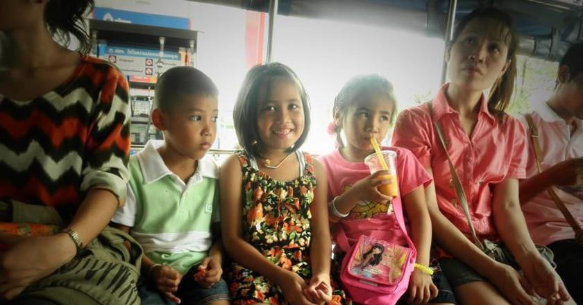 Local children in a Songtaew, Bangkok   © mkismkismk/Flickr