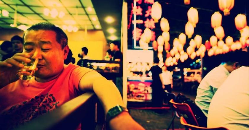 Chinese man drinking