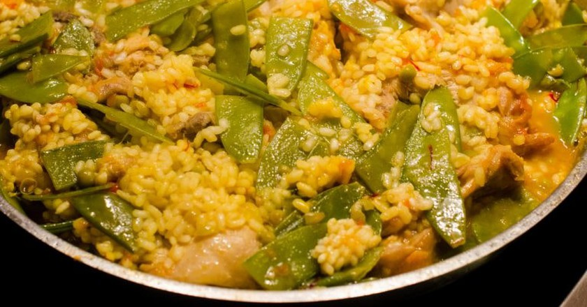 Paella Valenciana with rabbit, chicken and vegetables