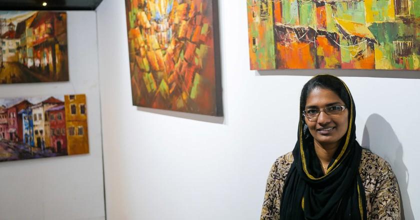 Sara Hussain's paintings hang on display in an art Cafe in Kochi | © Aditi Mukherjee