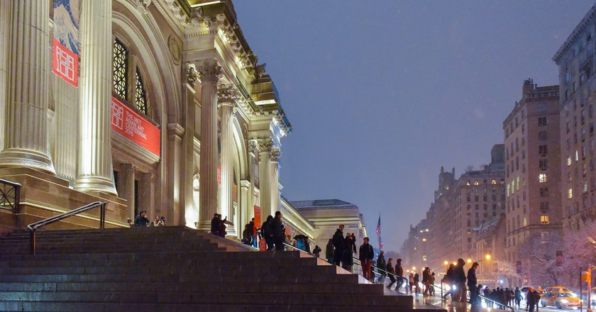 New York Street Scenes—Snowy Night Outside the Metropolitan Museum of Art on Fifth Avenue | © Steven Pisano/Flickr