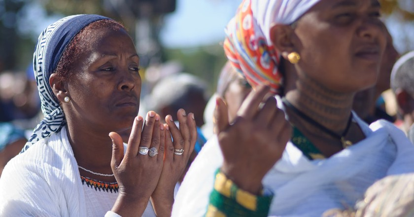 Ethiopian Jewish women pray at the Sigd in Jerusalem, Israel, 2014 | © RnDmS / Shutterstock