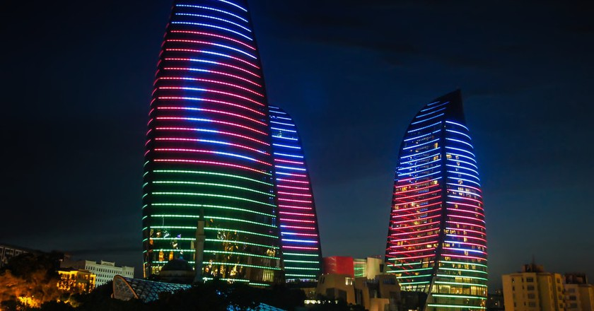 Baku's Flame towers with the Azerbaijan flag | © Kisov Boris/Shutterstock