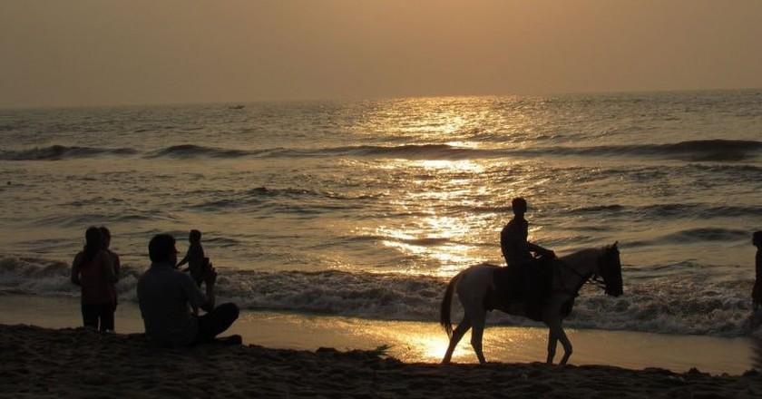 Visitors enjoying the sunrise at Besant Nagar Beach in Chennai |