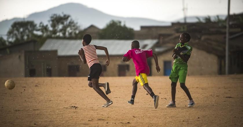 Rwandan girls playing soccer   Courtesy of Herve Irankunda