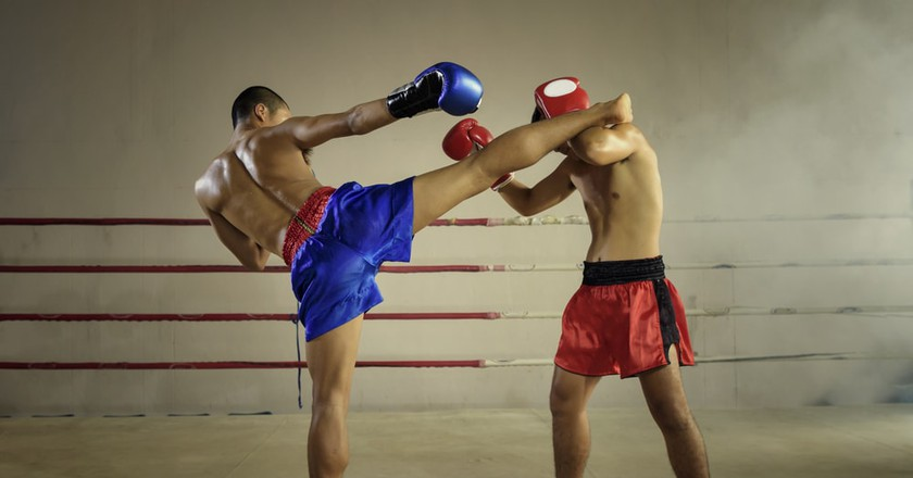 Muay Thai fighters practicing their techniques | © thanatphoto/Shutterstock