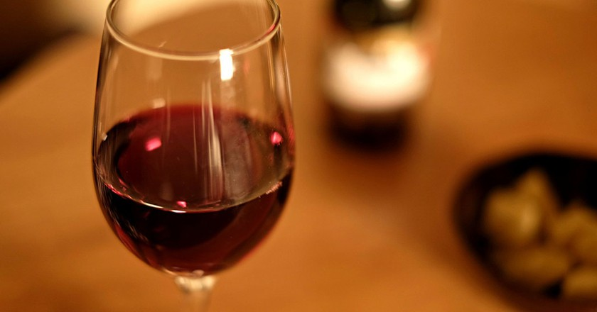 A glass of red wine enjoyed at dinner