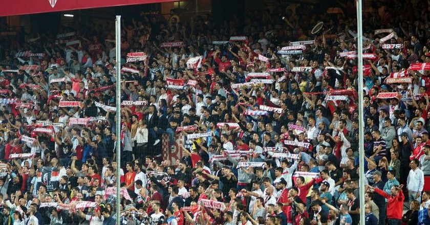 Sevilla FC fans support their team during a home match