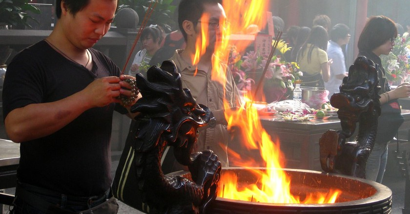 Locals visit temples during Ghost Month