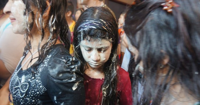 Girls covered in paste and water during Songkran