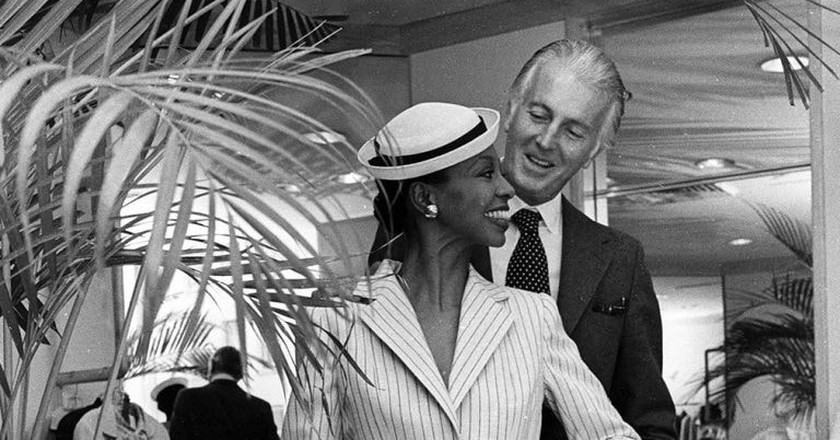 Givenchy with a model wearing a skirtsuit from the Givenchy Fall/Winter 1979 collection with hat Givenchy Spring 1979 HC, New York | © Dustin Pittman / Penske Media / REX / Shutterstock (6908712e)