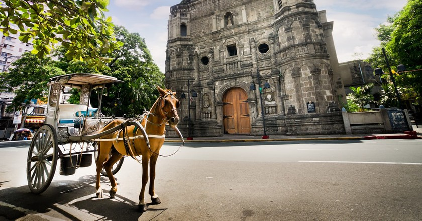 Horse-drawn calash in front of Malate Church in Manila, Philippines |
