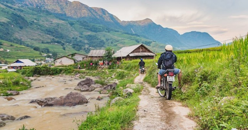 Tourists riding motorbikes near Sapa, Vietnam