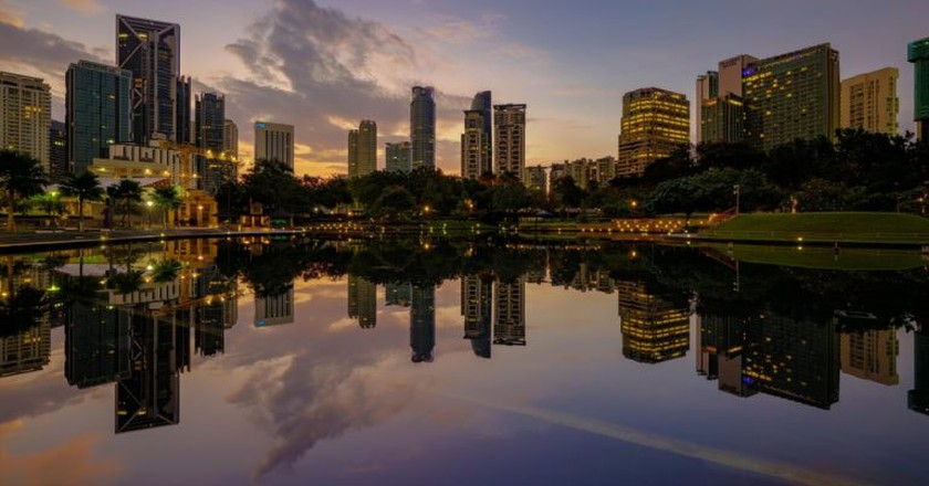 Sunrise view of KLCC lake and park   © Nur Ismail Photography/Shutterstock
