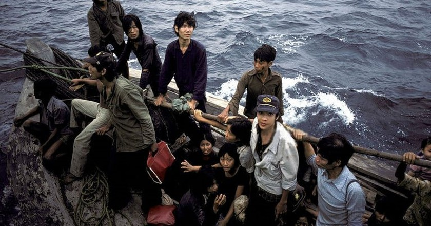 Vietnamese refugees fleeing their homeland by boat