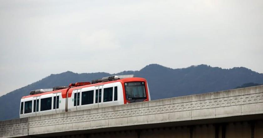A train heads along the Gimhae Light Rail tracks