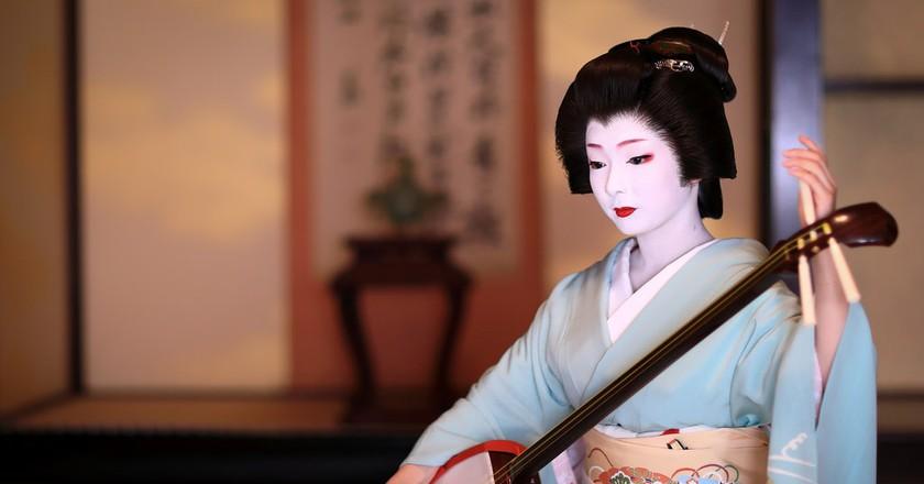 Toshimana, a Kyoto Geiko, plays the shamisen