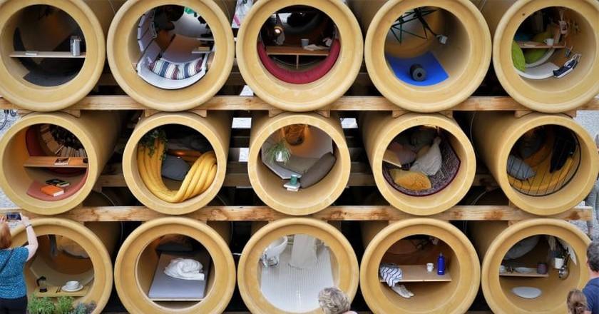 Refugee homes in tubes art installation