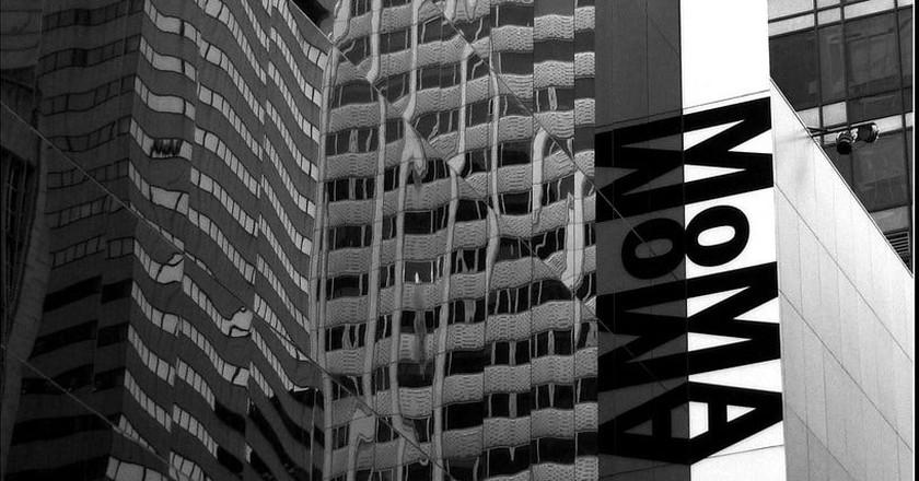 Exterior Reflection, MOMA, New York City | Photo by Tony Fischer/via Flickr.
