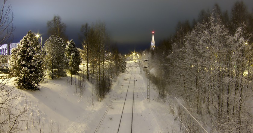 The snow-covered railway leading into Rovaniemi