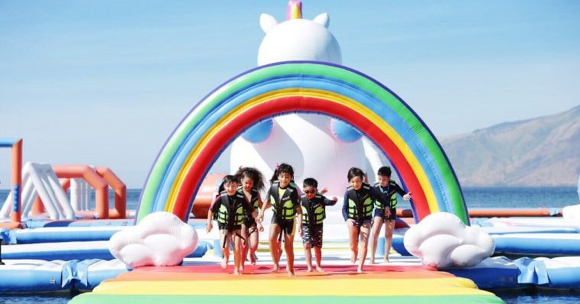 Kids running across rainbow walk at Unicorn Island