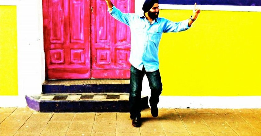 A Punjabi man dancing and having fun