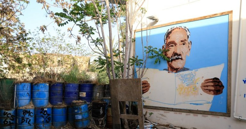 A portrait of a grandfather decorates the wall of a quiet street in Nicosia