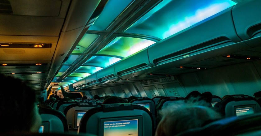 A view of the Northern Lights from inside a plane.
