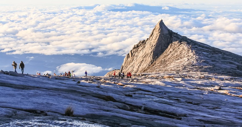 Challenge yourself to hike Mount Kinabalu and be rewarded with breathtaking views