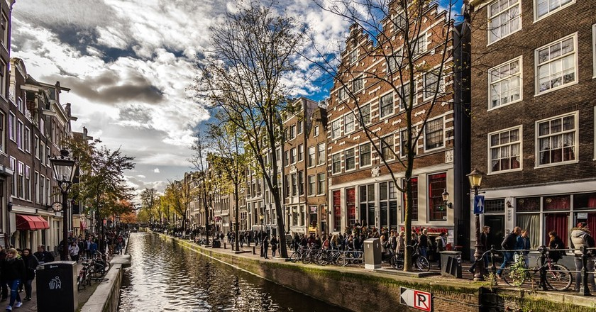 Blue skies above Amsterdam's canals