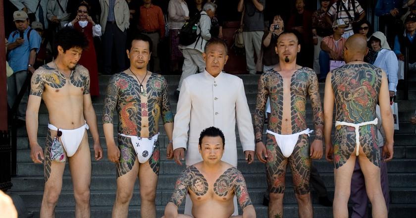 Men display their Yakuza-style tattoos at a festival in Asakusa, Tokyo