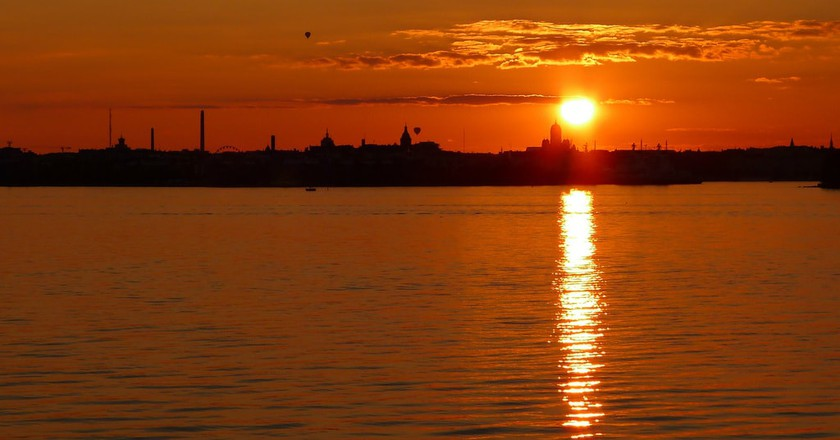 A golden sunset over Helsinki and the Baltic Sea.