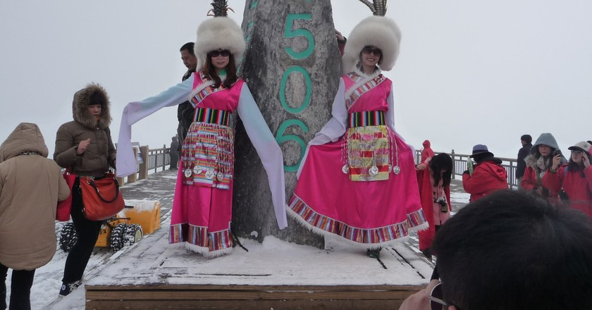 Tourists Dress in the Pumi Style