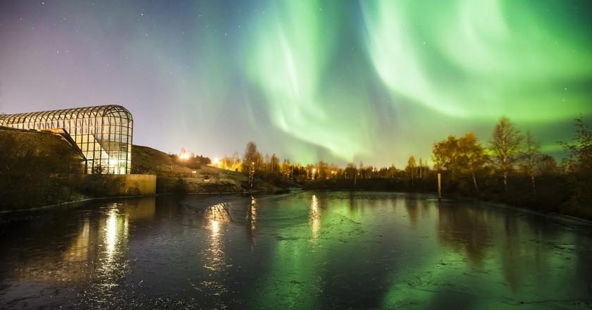 The northern lights shining over Arktikum.