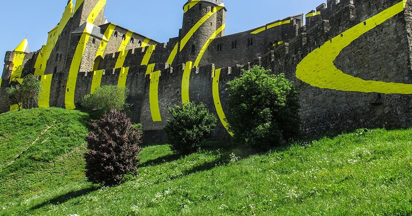 The medieval castle of Carcassonne with yellow concentric circles, France
