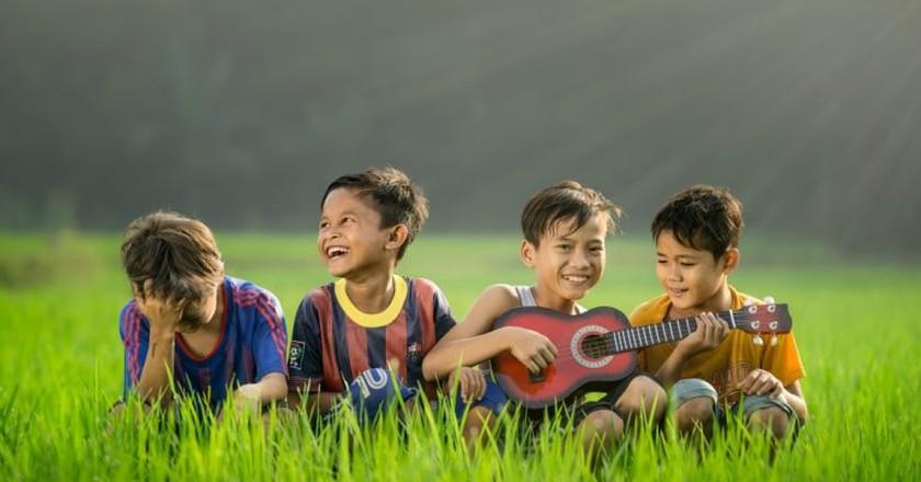 Children playing the ukulele