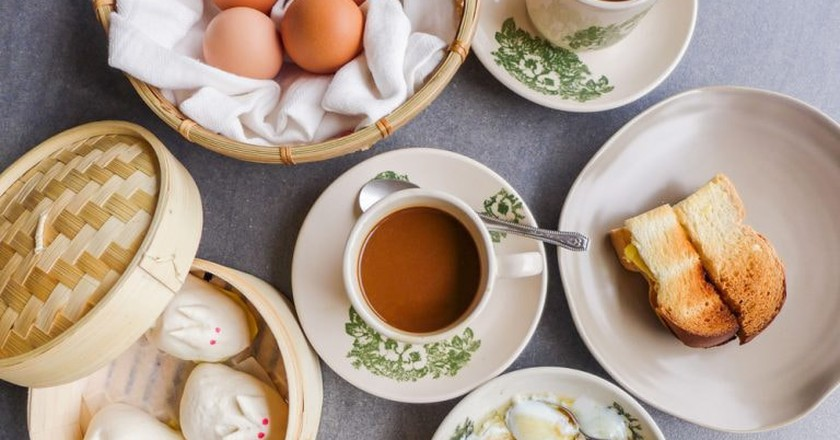 Coffee and half boiled eggs with toast