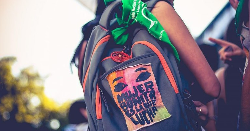 Tied to backpacks or worn around necks and wrists, the green handkerchief is a symbol of pride for young millenial activists.