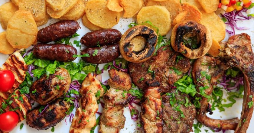 Cypriot mixed grilled meat with vegetables and potatoes