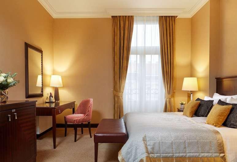 The interior of the Corinthia Hotel recalls a grand 19th-century hotel
