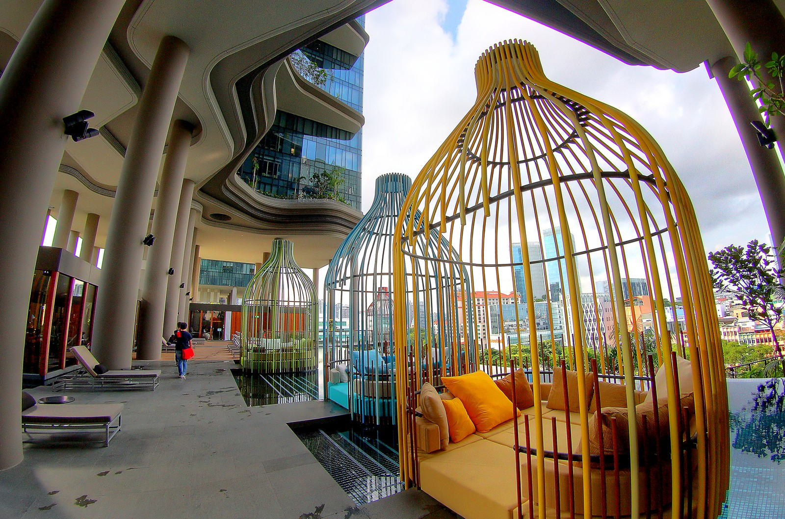 Colourful birdcage cabanas to lounge in by the infinity pool