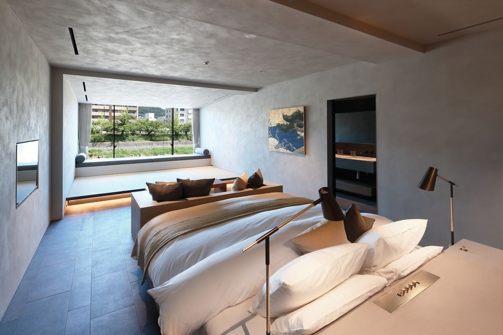Rooms at Aoi Hotel feature minimalist decor with Japanese accents and river views