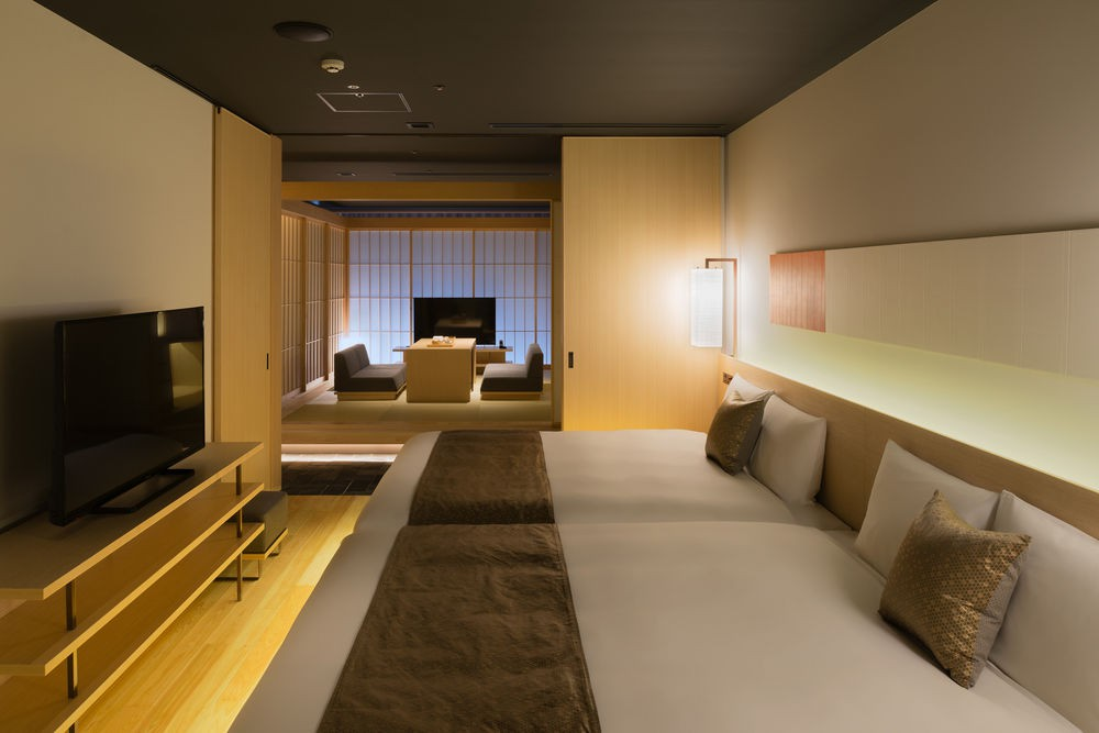 The spacious, Japanese-style rooms at Hotel Kanra incorporate Western elements such as plush beds