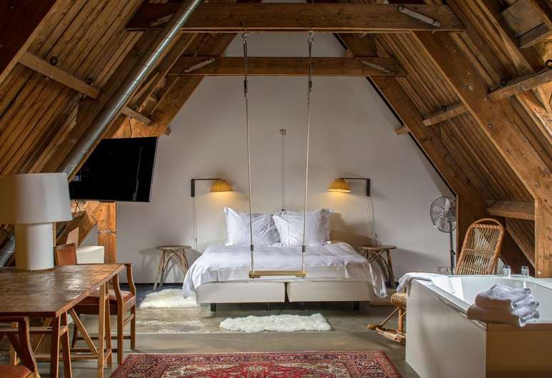 A-frame rooms at the Lloyd Hotel feature quirky touches such as swings