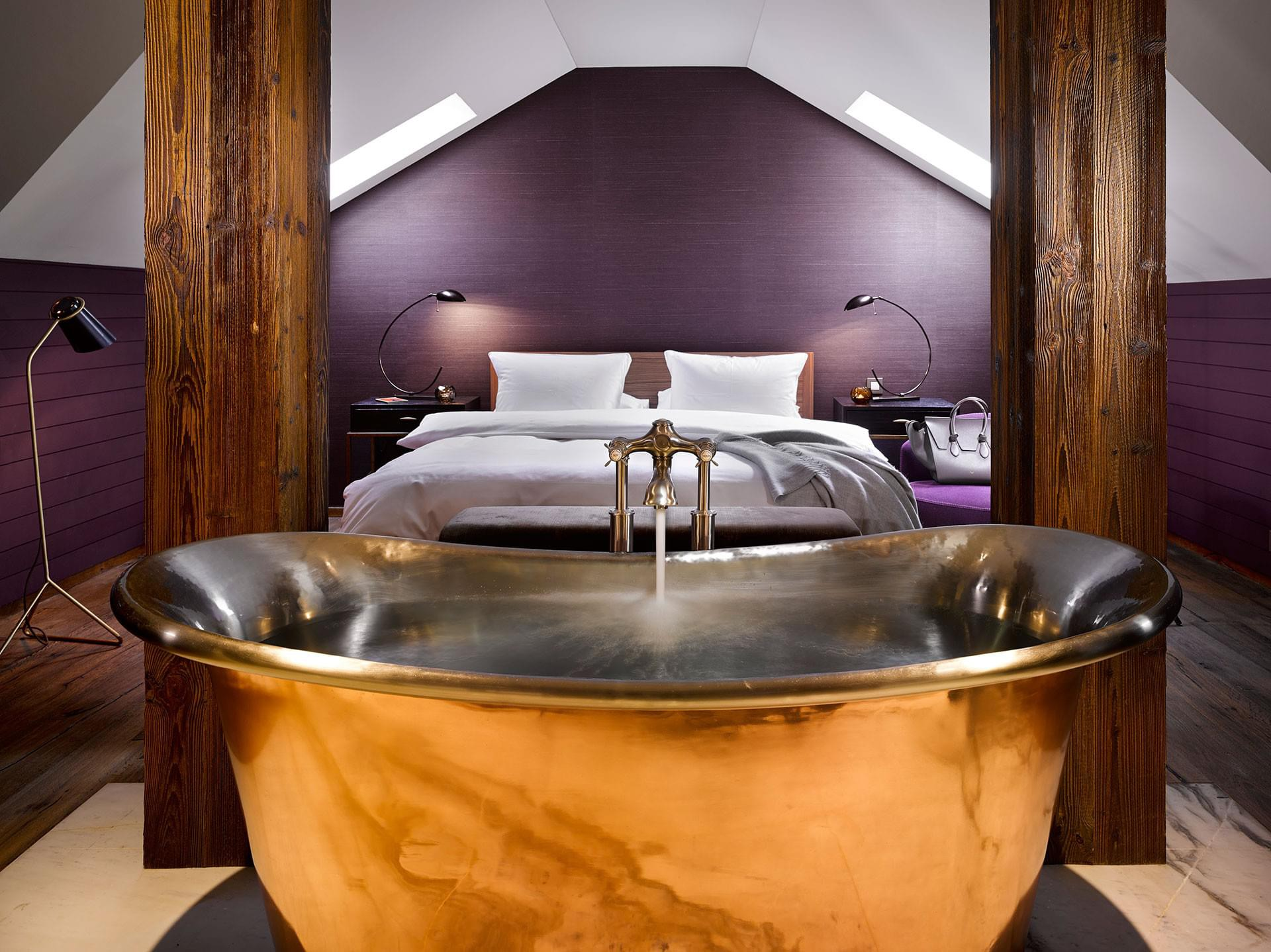 Rich shades of plum and copper make the suites at The Emblem Hotel feel luxuriously cosy